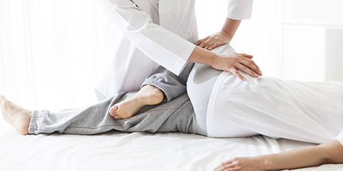 Osteopathic Doctor Treating Leg And Hip Web1